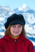 Happy woman portrait on winter mountain background. — Stock Photo