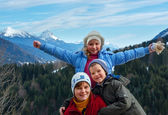 Family and winter mountain landscape — Stock Photo