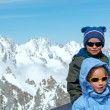 Stock Photo: Family and Mont Blanc mountain massif behind (France )