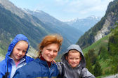 Family portrait in Alps mountain — Stock Photo
