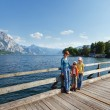 Traunsee summer lake (Austria) and family. — Stock Photo