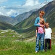Family  on summer Alps mountain - Stock Photo