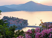 Sunset over the sea islet of Sveti Stefan (Montenegro) — Stock Photo