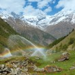 ������, ������: Rainbows in irrigation water spouts in Summer Alps mountain