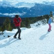 Stock Photo: Family plays at snowballs on winter mountain slope