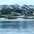 Alps mountain lake (spring panorama). — Stock Photo