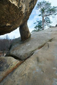 Lofty stones on sky background — Stock Photo