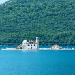 Artificial island with a church on it (Perast, Montenegro, Kotor — Stock Photo #32036325