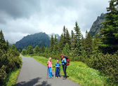 Family and High Tatras (Slovakia) summer view. — Photo