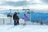 Family on ski station top and snowfall (Molltaler Gletscher, Aus — Stock Photo