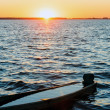 Sunset and drowned boat on summer lake bank — Stock Photo #33769789