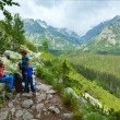 High Tatras (Slovakia) summer view and family on footway. — Stock Photo #33770993
