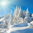 Sunshine under the winter mountain landscape — Stock Photo