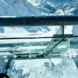 Stock Photo: Winter Dachstein mountain massif through glass floor.