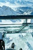 Winter Dachstein mountain massif through the glass floor. — Stock Photo