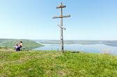 Wooden Cross and Bakota spring view (Ukraine) — Stock Photo
