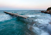 Evening sea storm and ruined pier (Black Sea, Bulgaria). — Stock Photo