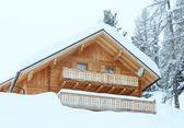 Wood house in winter misty mountain — Foto Stock
