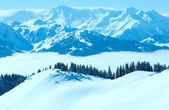Cloudy sunny winter mountain landscape — Foto Stock