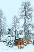 Wood house in winter misty mountain — Foto Stock