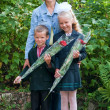 Mother with little schoolgirl and schoolboy — Stock Photo