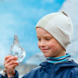 Boy with ice piece near Nigardsbreen glacier (Norway) — Stock Photo #36786105
