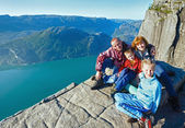 Happy family on Preikestolen massive cliff top (Norway) — Stock Photo