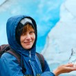 Woman with ice piece near Nigardsbreen glacier (Norway) — Stockfoto #37442259