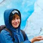 Woman with ice piece near Nigardsbreen glacier (Norway) — Photo