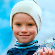 Stock Photo: Boy with ice piece near Nigardsbreen glacier (Norway)