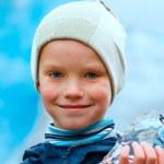 Boy with ice piece near Nigardsbreen glacier (Norway) — Photo