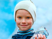 Boy with ice piece near Nigardsbreen glacier (Norway) — Stock Photo