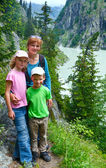Family in summer Alps mountain (Switzerland). — ストック写真