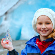 Girl with ice piece near Nigardsbreen glacier (Norway) — Stock fotografie