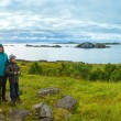 Family near summer Senja coast (Norway, polar night) — Stock Photo #40373583