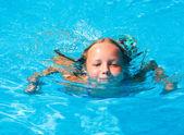 Girl in summer outdoor pool. — Stock Photo
