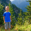 Boy in summer mountain (Romania). — Stock Photo