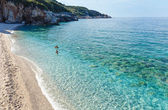 Family swimming in Aegean Sea (Mylopotamos beach, Greece). — Stock Photo