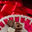 Arrangement of heart shaped chocolates - Stock Photo