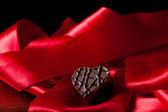 Almond cream heart shaped chocolate — Stock Photo
