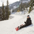 Snowboarder resting — Stock Photo