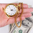 Hand, time and money — Stock Photo