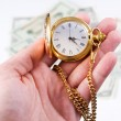 Hand, time and money — Stock Photo #19955025