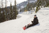 Snowboarder resting — Stock Photo