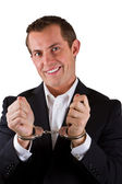 Happy arrested busniessman — Stock Photo