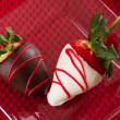 Arrangement of chocolate covered strawberries — Stock Photo