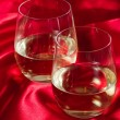 Stemless white wine glasses - Stock Photo
