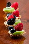 Fresh mini fruit tarts — Stock Photo
