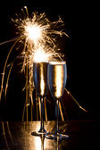 Champagne and fireworks — Stock Photo