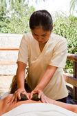 Hot stone massage — Stock Photo